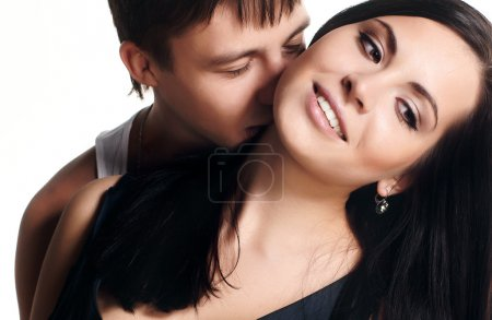 Photo for Happy smiling couple in love. Over white background - Royalty Free Image