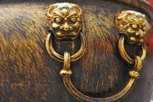 Ancient bronze lions as a handle of vat