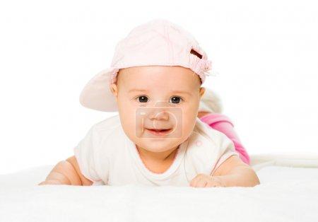 Portrait baby girl wearing pink hat