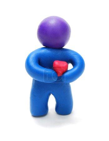 Plasticine Man Holding Heart