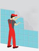 travailleur de la construction en costume rouge pose t