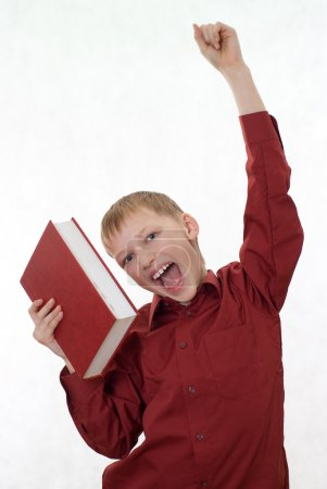 Boy in a red shirt jumps from a book