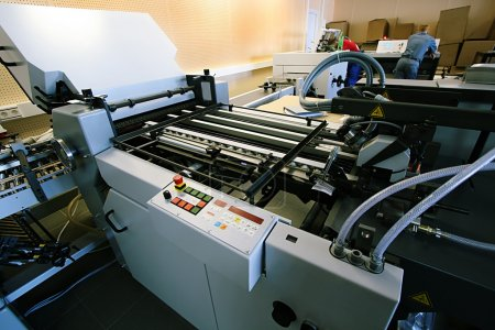 Photo for The new polygraphic machine in a modern printing house - Royalty Free Image