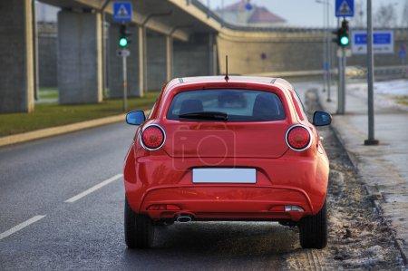 Photo for Red car view from rear, near the bridge, Riga, Latvia - Royalty Free Image