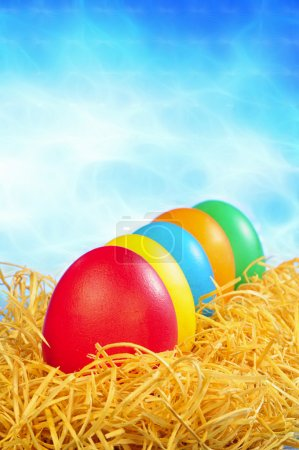 Photo for Five painted eggs on a straw on a clear sky background - Royalty Free Image