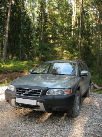 4x4 European wagon parked on a forest.