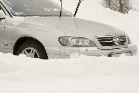 Car in snow. Editorial image.