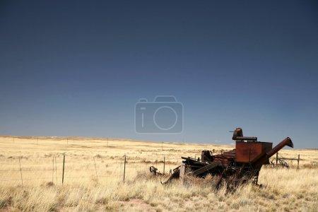 Vintage combine harvester and old field