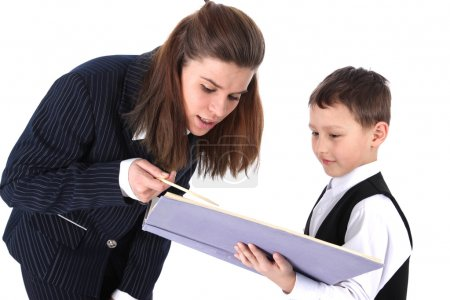 Teacher and boy with book