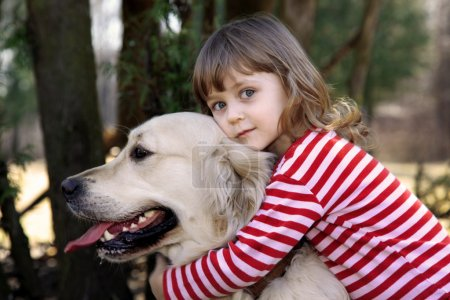 Little girl with big retriever