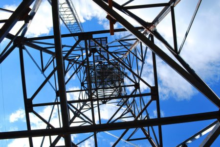 Photo for Abstract high-voltage tower on blue sky background - Royalty Free Image
