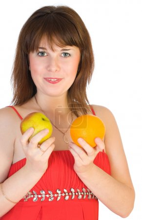 Girl with orange and apple in hands