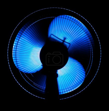 Photo for Big office fan in blue light isolated on black - Royalty Free Image