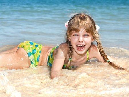 Happy girl at sea beach.