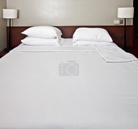 Luxury bedroom with white bedding.