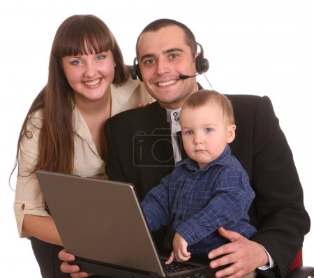 Happy family with laptop and headset.