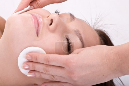 Beautiful woman in spa. Facial massage.