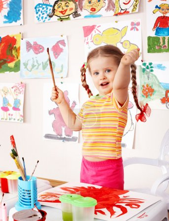 Child with picture and brush