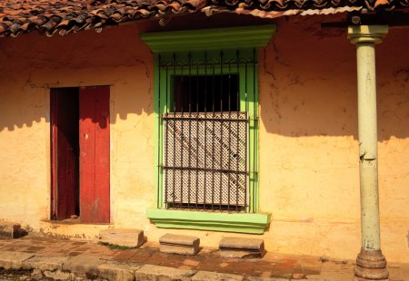 Old door and window in colorful wall