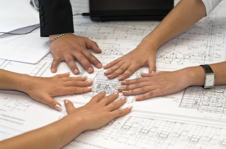 Photo for Human hands on table with a project drawings. - Royalty Free Image