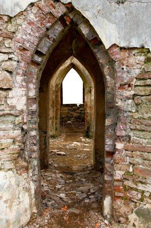 Ancient arches through the brick walls w
