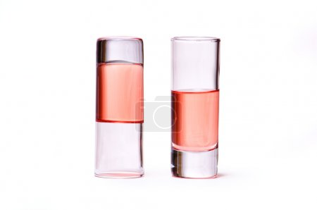 Thin glasses with pink liquid