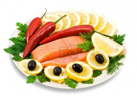 Red fish, lemon, olives on plate isolate
