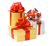 Gold and silver boxes with gifts and bow