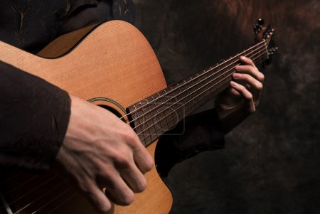 Photo for Hands with a guitar - Royalty Free Image