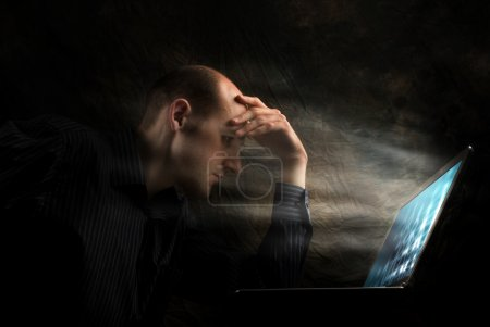 Photo for Businessman looking seriously at screen. - Royalty Free Image