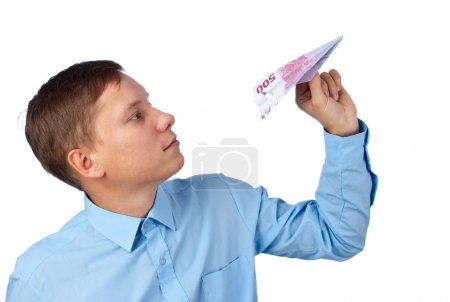 Photo for Businessman throwing an airplane against white background - Royalty Free Image