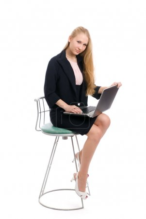 Photo for Young blond business woman sitting with laptop on white - Royalty Free Image