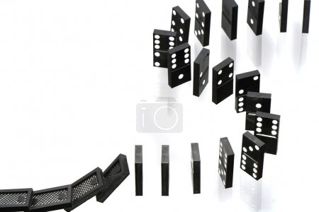 A stack of dominoes falling on white background wi...