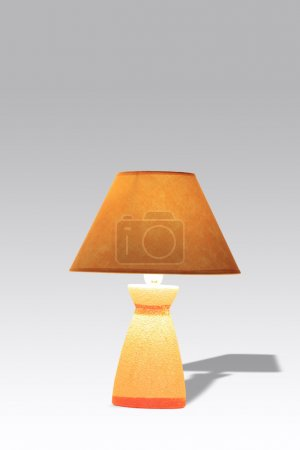 Photo for Nice luminous table lamp with yellow shade isolated on gradient background with clipping path - Royalty Free Image