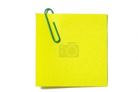 Yellow sticker note with a green clip isolated on ...