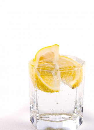Glass with soda water and lemon