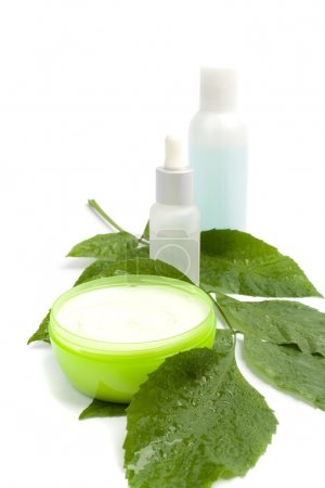 Photo for Cosmetic products with green leaf on white background - Royalty Free Image