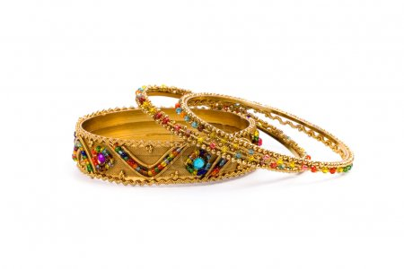 Three golden bracelets