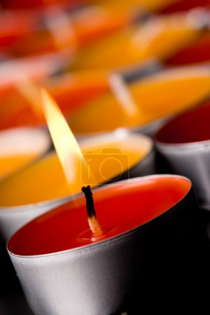Photo for Macro image flaming candles on a dark background - Royalty Free Image