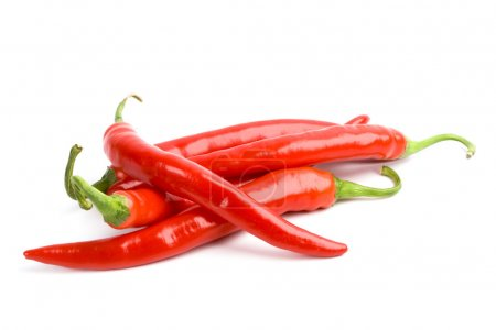 Four red chili peppers