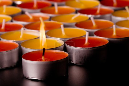 Photo for Flaming candle closeup on black. background - Royalty Free Image
