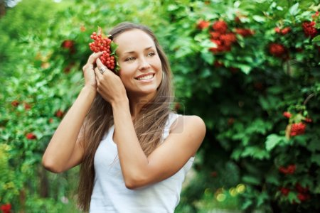 Beautiful woman with guelder rose