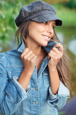 Attractive young woman dressed in jean j