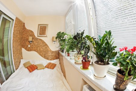 Sunny bedroom on balcony with Window and