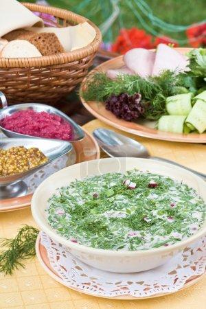 Summer kvass soup (okroshka) on served t