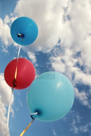Three vivid color balloons on blue sky