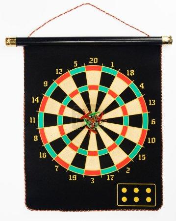 Darts set on a black sheet board