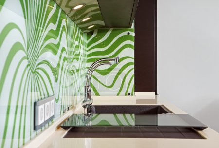 Part of modern Kitchen interior with Sink and green pattern wall