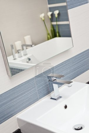 Part of modern bathroom in blue and gray