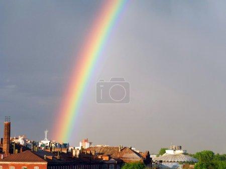 Rainbow multi color image in blue sky